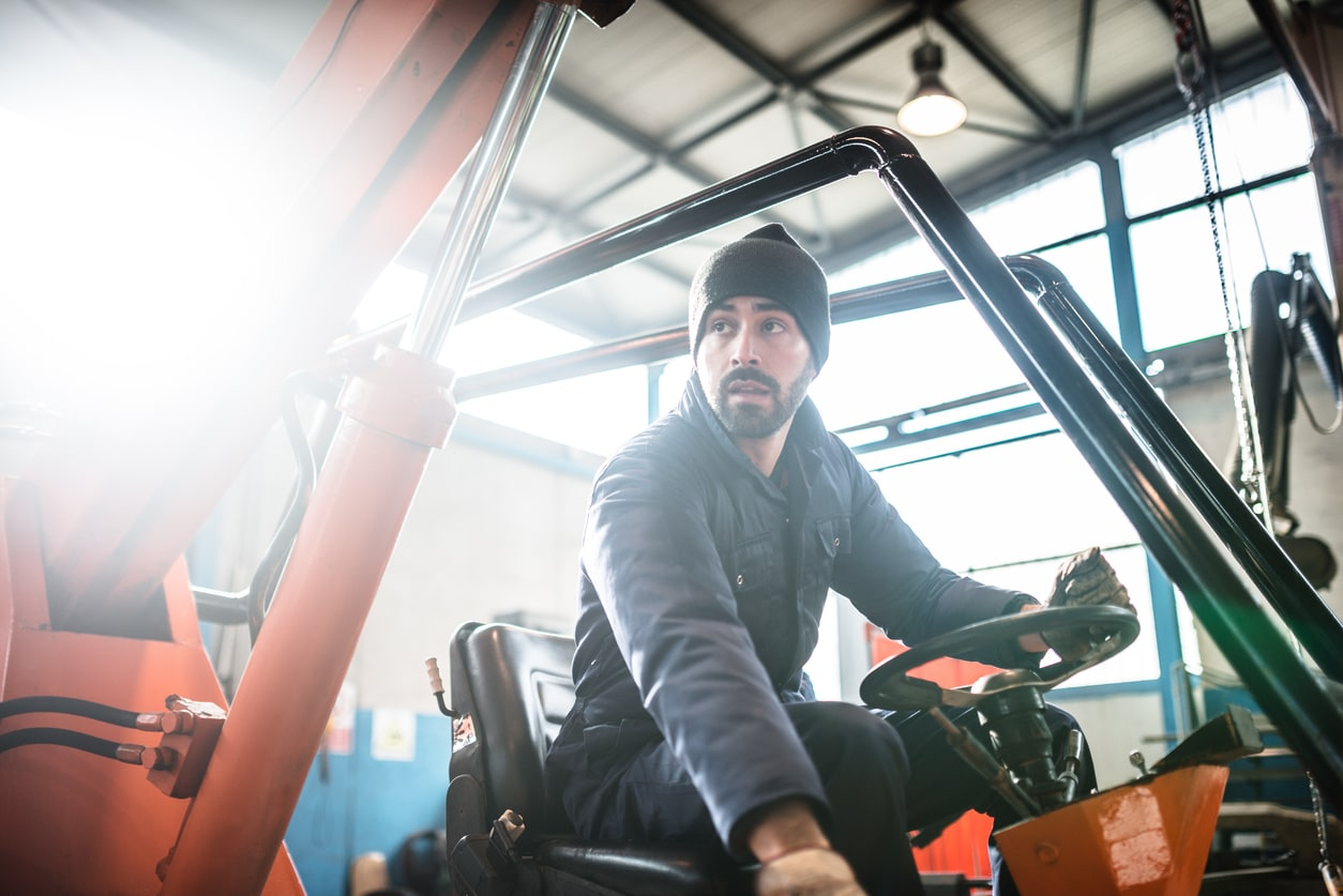 a man on a forklift
